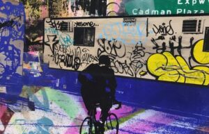 Mural With Cyclist and Graffiti